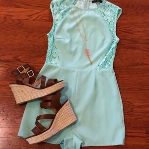 mint green romper with lace siding